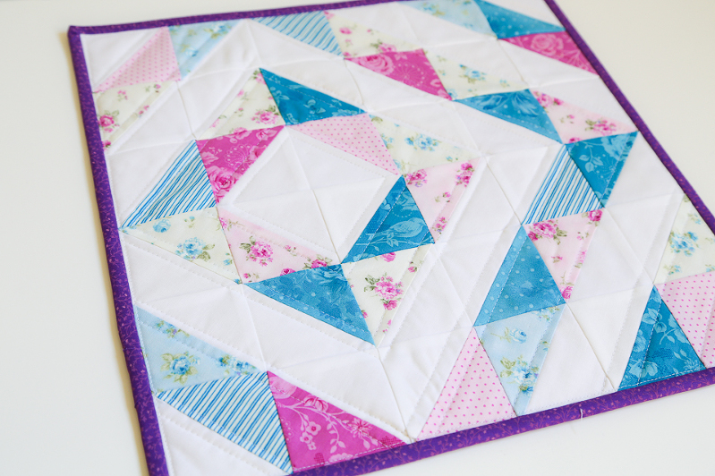 half square triangles, quilting with HST, HST quilt, mini charm squares quilt, eleanor burns quilt, quilts with diamonds, quilts for girls, mini quilts, floral mini quilts, purple quilts, blue quilts, purple quilt binding