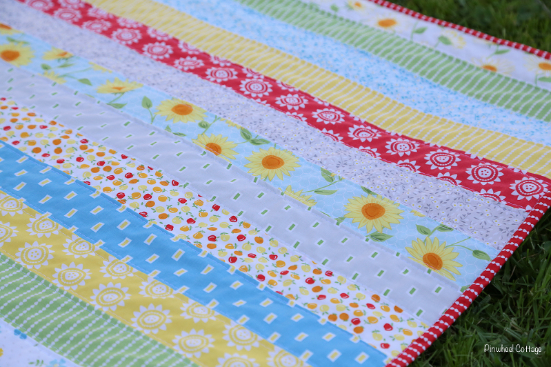 Oh Clementine quilt, cluck cluck sew quilt, jelly roll quilt, jelly strips quilt, precuts quilt, moda fabrics quilt, quilts for kids, babies, quilts with flowers, strip quilt