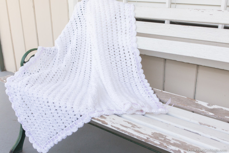 White Crochet Baby Afghan with a Purple Ribbon
