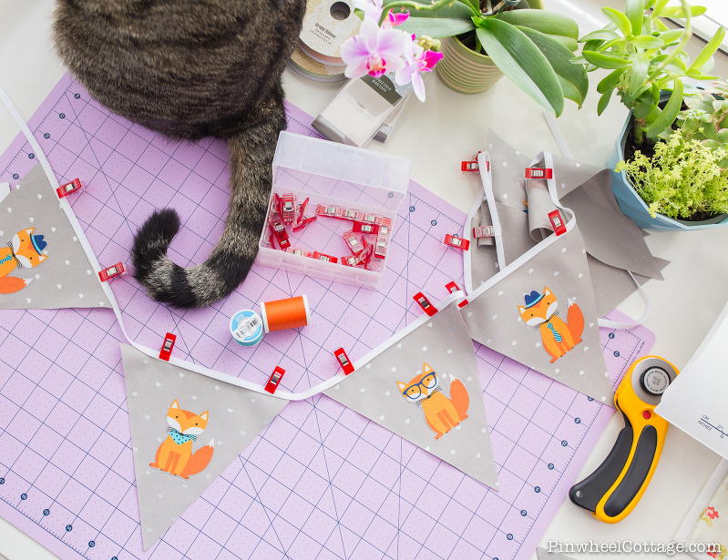 Little Foxes Bunting Banners, cat tail, sewing table, Little Foxes Bunting Banner, bunting banner tutorial, free sewing pattern, how to make bunting banners