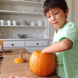 boy carving pumpkin, halloween pumpkin carving