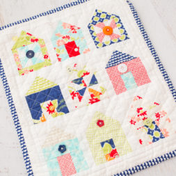 thimbleblossoms dwell mini quilt, mini quilts, table topper quilts, house quilt, wall quilts, quilts with houses and buttons, miss kate fabric quilt