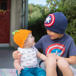 brother and sister photo shoot, pumpkin and captain america, sibling photography, crochet beanies