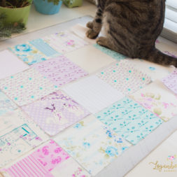 patchwork squares, charm square fabric, cat fabric, cats and quilting, purple and blue quilt, cats on quilts